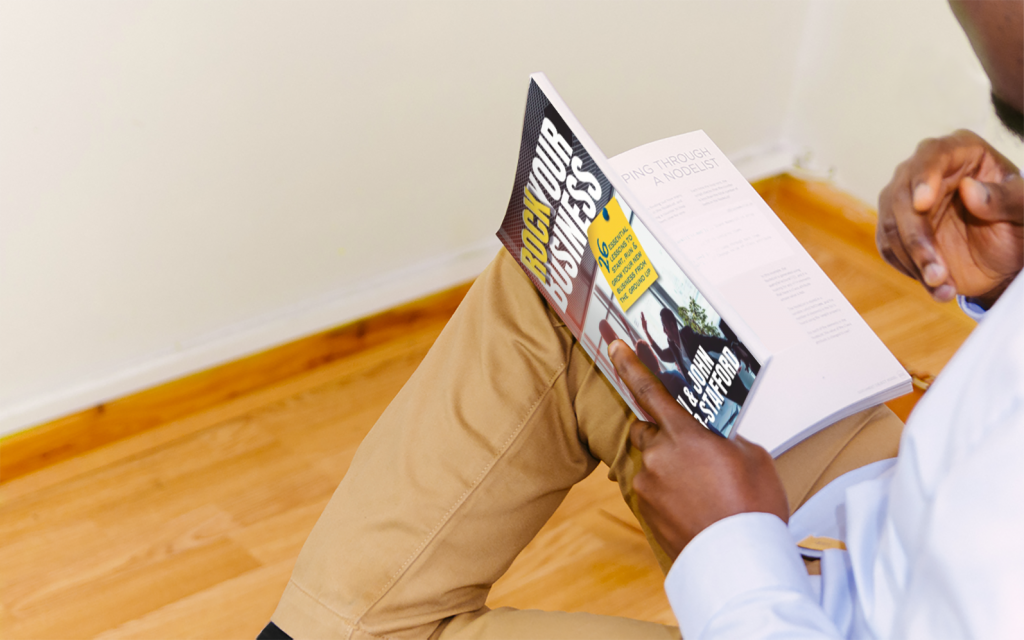 Guy reading Rock Your Business book
